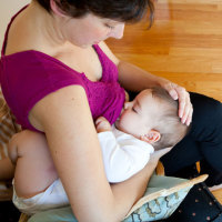 Top Breastfeeding Tips for Successful Nursing - Crossover Hold