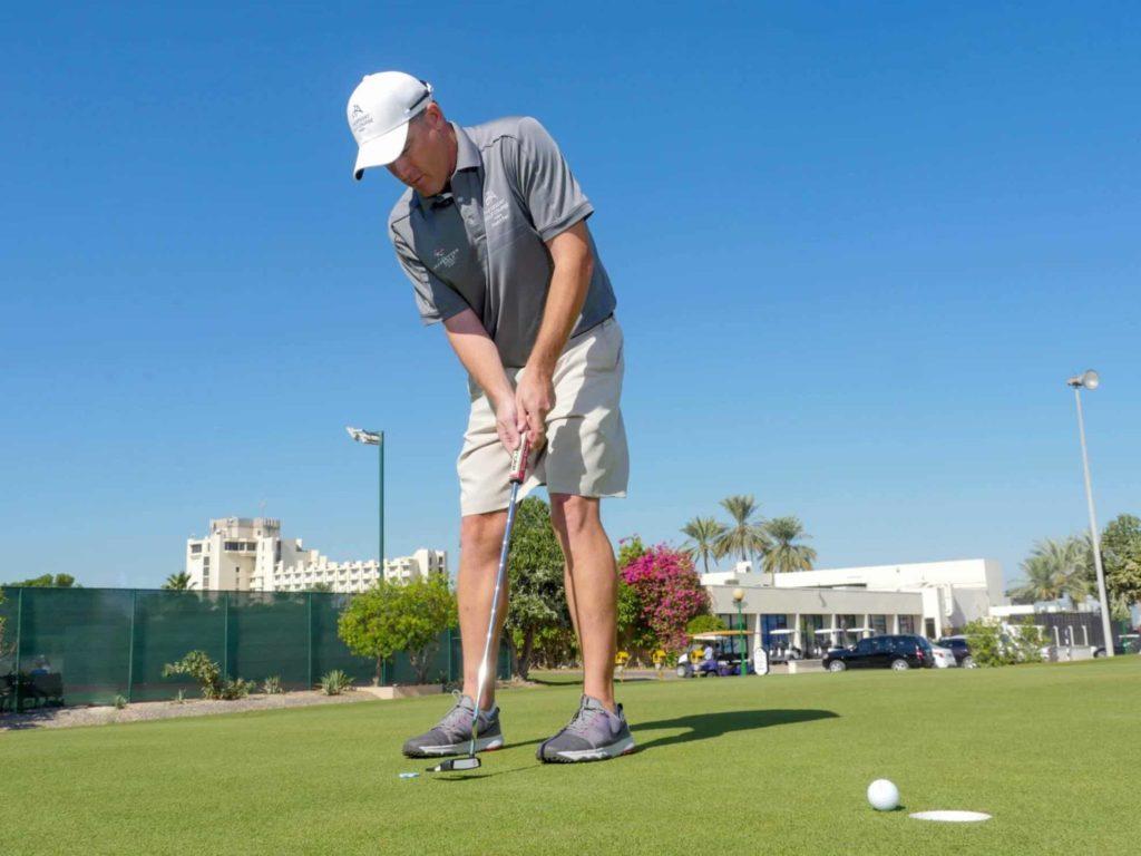 How to Swing a Golf Club: Beginners Guide- Keep Head Down