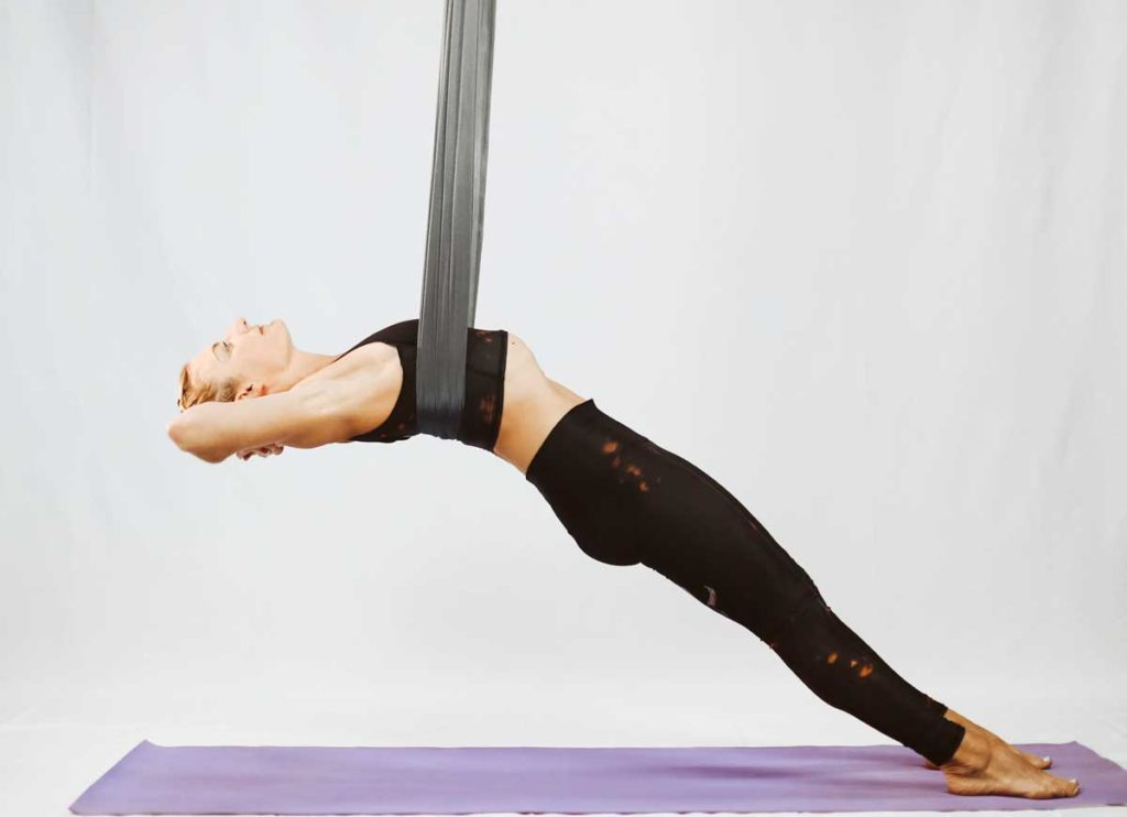 Aerial Yoga Guides for Beginners – What to Know and How to Do - Shoulder Stretches in the Wrist Wrap - Layback in a Cross Position