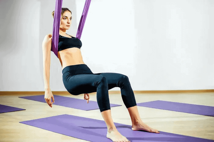 Aerial Yoga Guides for Beginners – What to Know and How to Do - Chair in Cross Position